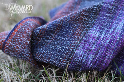 Woven wrap, gently piled on grass