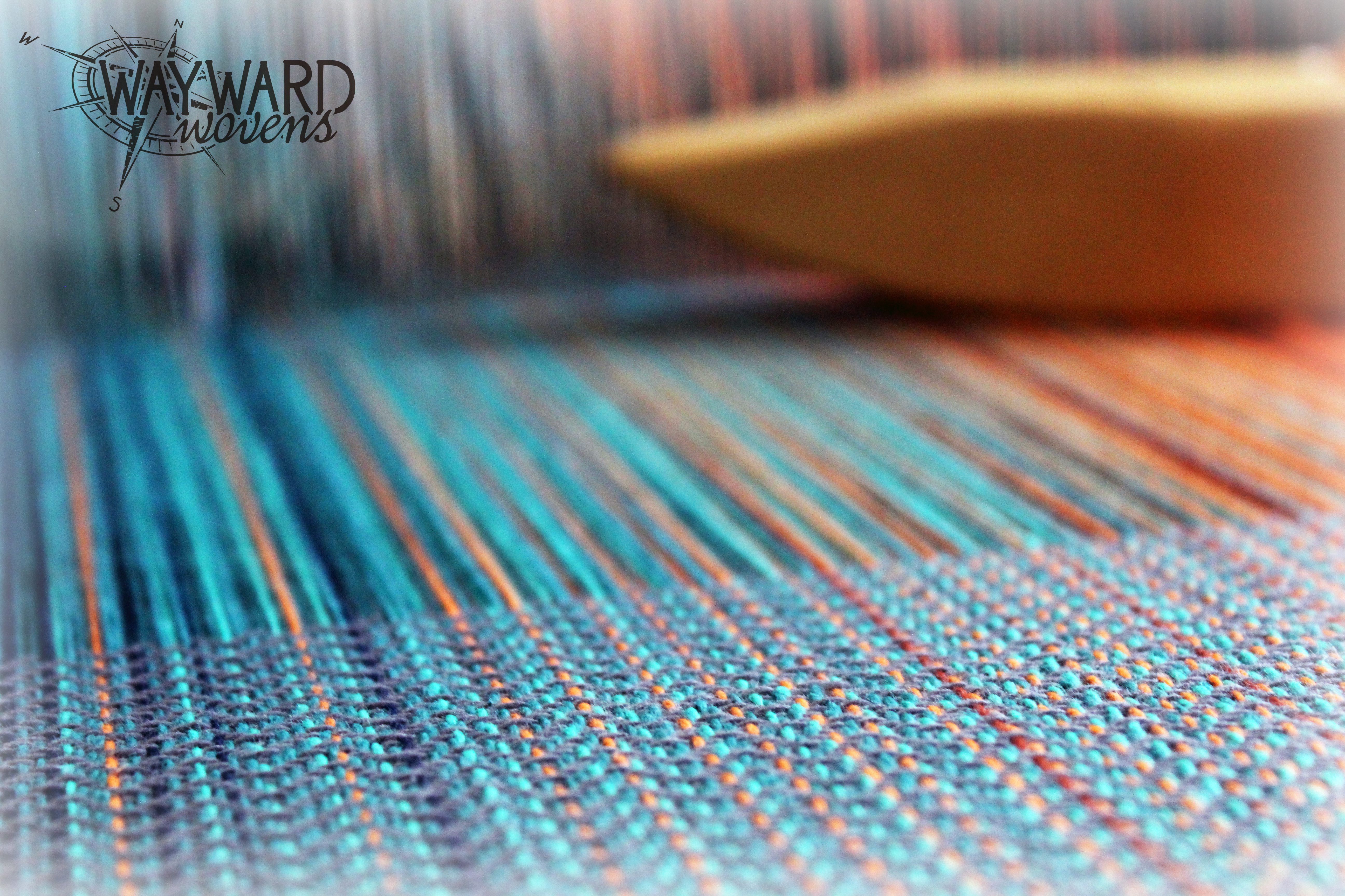 Grey cotton weft, on the loom