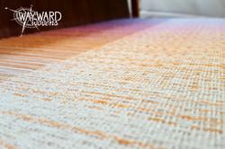 Woven cloth on loom