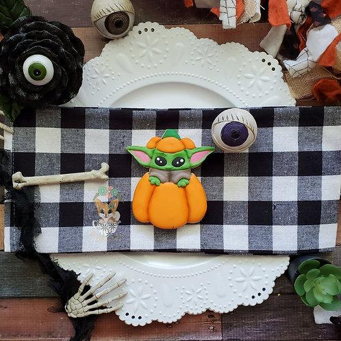 Baby Yoda with pumpkin top