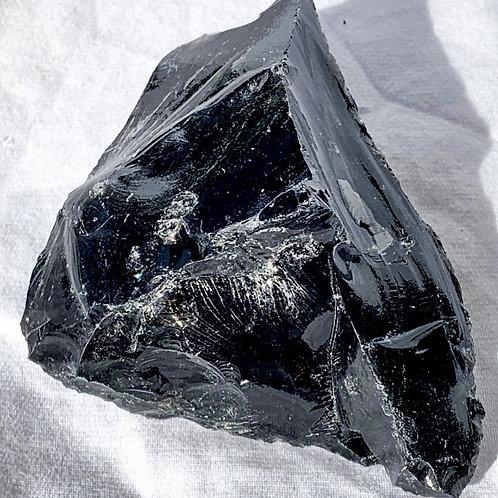Raw obsidian piece
