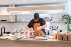 Chef James creating