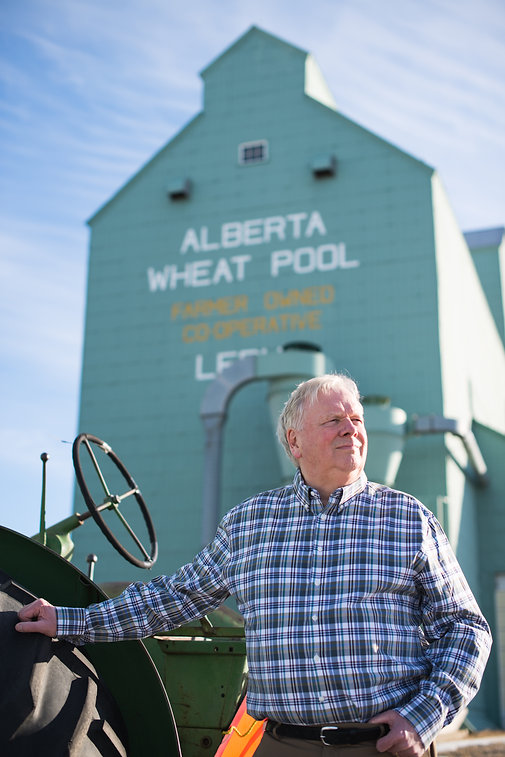 Lynn Schrader standing in front of leduc grain elevator