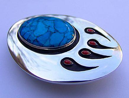 Ma'iingan Nindoodem silver wolf paw belt buckle handcrafred by Zhaawano Giizhik