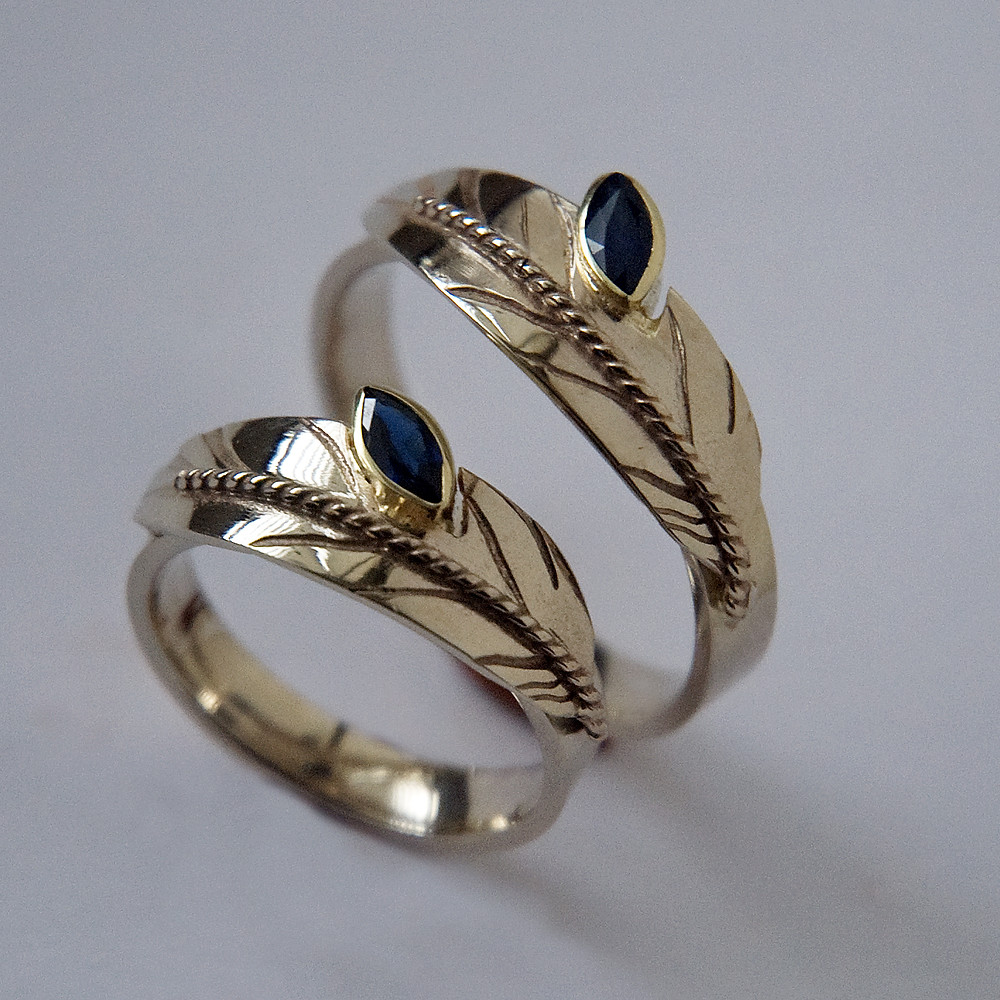 Designer rings of white gold created by Zhaawano Giizhik