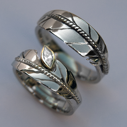 New Growth feather wedding rings
