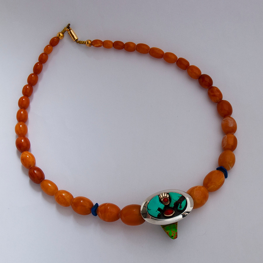 Bimose-makomiikanakwe necklace of amber beads, silver, gold, turquoise, and red coral.