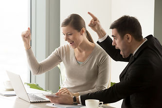 happy-businesspeople-celebrating-online-business-success.jpg