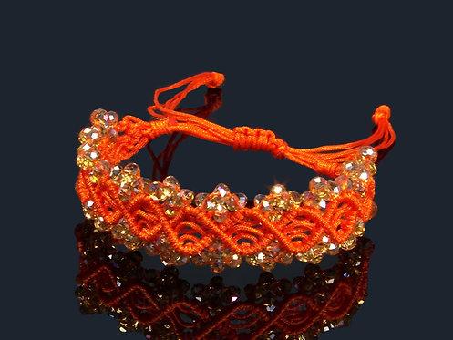 Браслет плетеный с цирконами цв.оранжевый