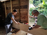 Luis cuts wood for new home in Guatemala