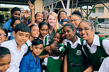 Brenna with Trinidad kids 2020.jpeg