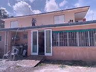 Kirsten works on hurricane damaged house