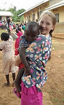 Brenlee with new friend in Uganda 2018.j