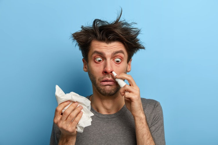 sick-man-injects-nasal-drop-blocked-nose