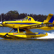 Water scooping aircraft for firefighting