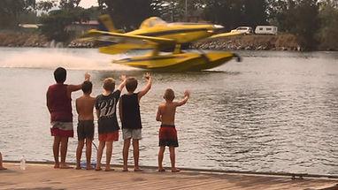 Kids waving at airtractor fireboss