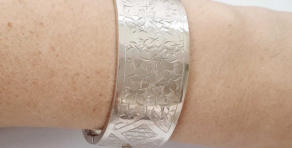 Antique Sterling Silver Hinged Bangle with Engraved Maple Leaf Pattern