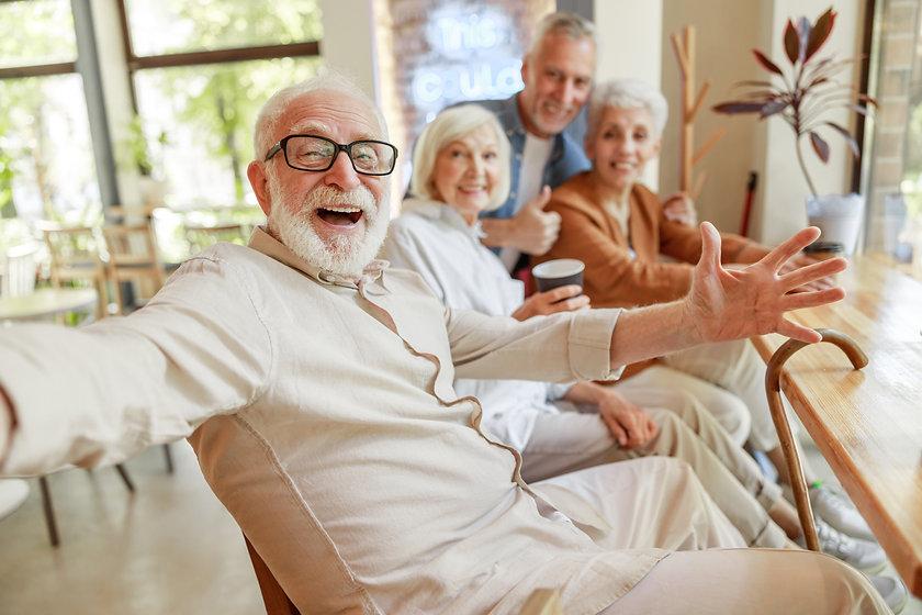 Joyful senior man spending time with fri