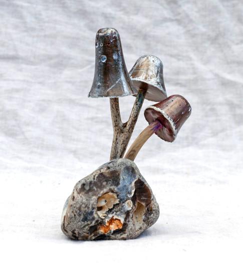 Painted mushrooms on pebble
