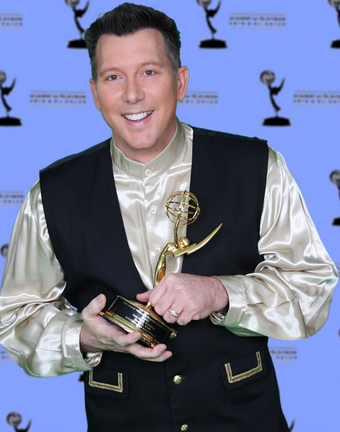 David L Cook wins an Emmy Award
