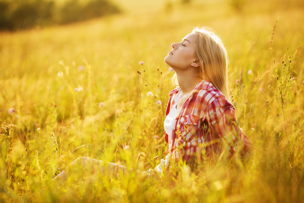 girl with closed eyes in sunlight