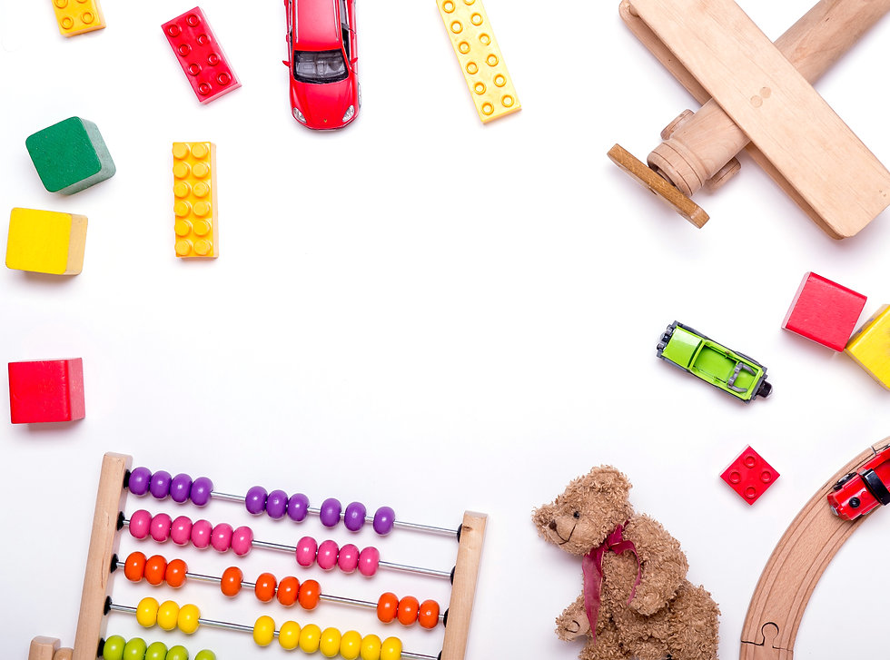 Top view of kids toys background. Wooden