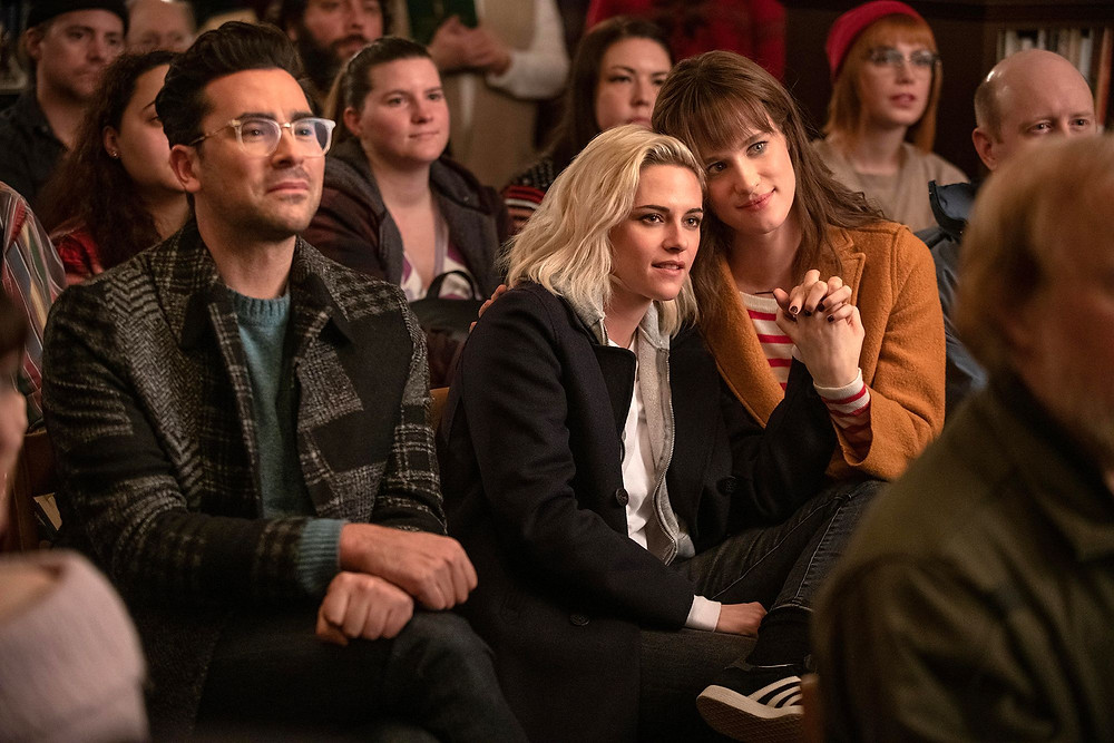 John (Matt Levy), Abby (Kristen Stewart) and Harper in an audience of show, Abby and Harper are lovingly clutching hands