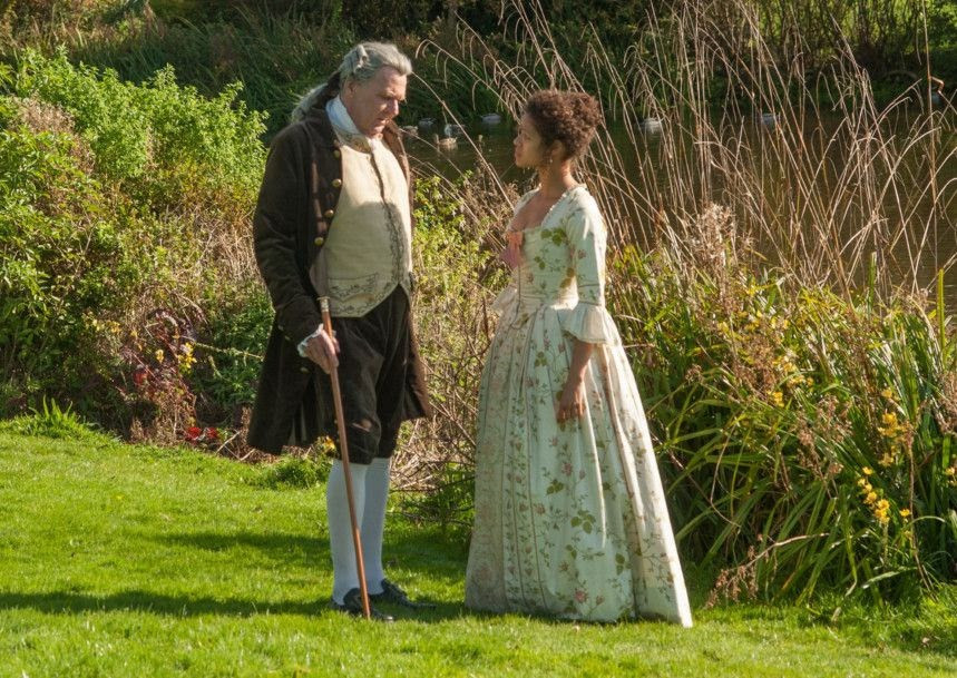 A still from Belle: Dido Belle stands in a garden talking to Lord Mansfield.