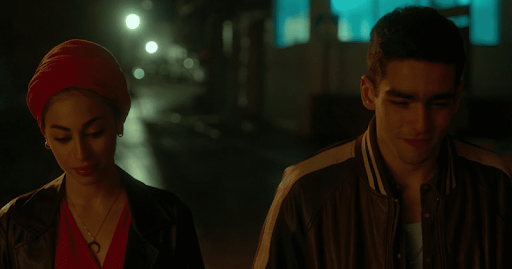 A still from Netflix Elite: Nadia and Omar walk down a dark street side by side