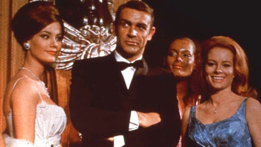 Sean Connery and three other women pose at a premiere event for Thunderball Bond film (1965)