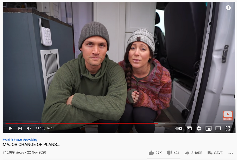 Kara and Nate (two vloggers) sit in the back of a van talking to camera. The video title reads 'MAJOR CHANGE OF PLANS'