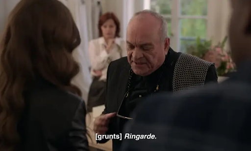 An old man looks downwards like he's scoffing, the subtitle on screen reads '[grunts] Ringarde'
