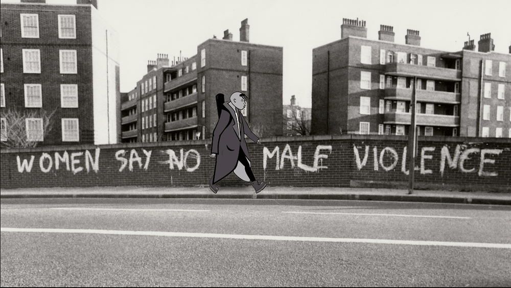 A still from Rebel Dykes: a bridge in London with 'WOMEN SAY NO TO MALE VIOLENCE' in graffiti across it, a cartoon character walks past