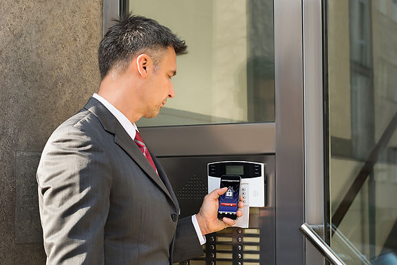 man using phone for entry, smartphone access control, mobile access control, smartphone entry systems, mobile access systems