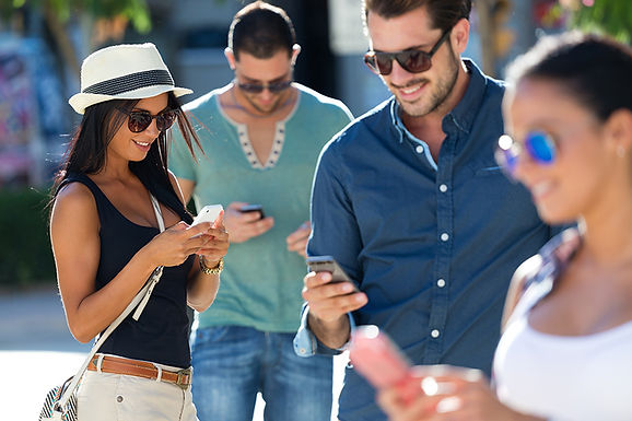 people using phones, smartphone access control, mobile access control, smartphone entry systems, mobile access systems
