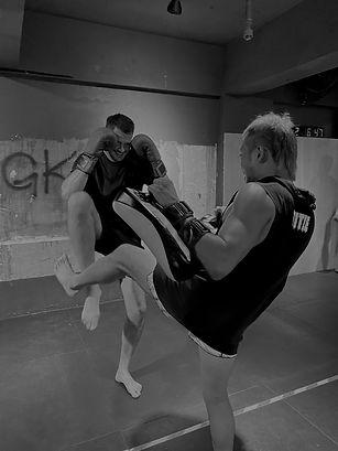 Coach Robin training kicks in Muay Thai Class