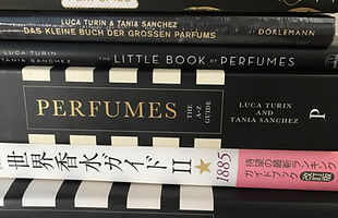 Stack of US, UK, Japan, and Germany editions of Perfumes: the A–Z Guide and The Little Book of Perfumes