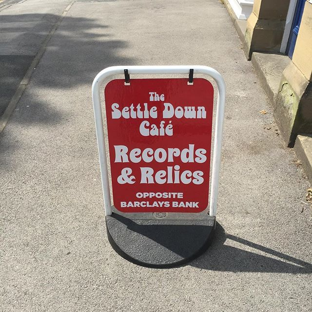 Upcycle of an old swing sign with new vinyl lettering & logo design for the Settle Down Cafe