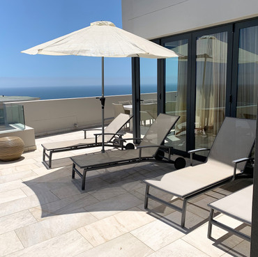 View of loungers on the top deck by the private use swimming pool.