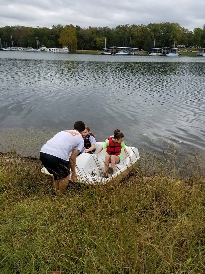 Timothy launching the paddle boat