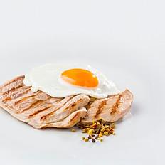 Pork steak topped with egg