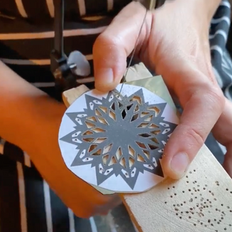 Cutting out a Christmas design from brass sheet