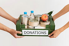 hands-holding-donation-box-with-provisio