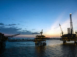 Silhouette of offshore production platfo