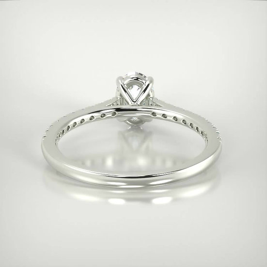 Oval diamond centre with petite micro set band