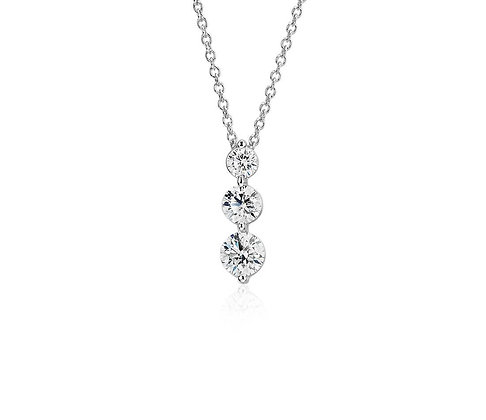 Round Diamond single claw drop 3-stone pendant