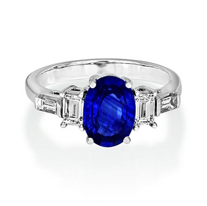 Fine Oval Cut Sapphire 2ct and Baguette diamond Ring