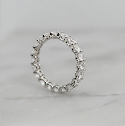 Round diamond shared claw full eternity band