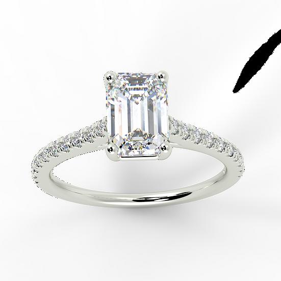 Emerald cut diamond with petite micro set band