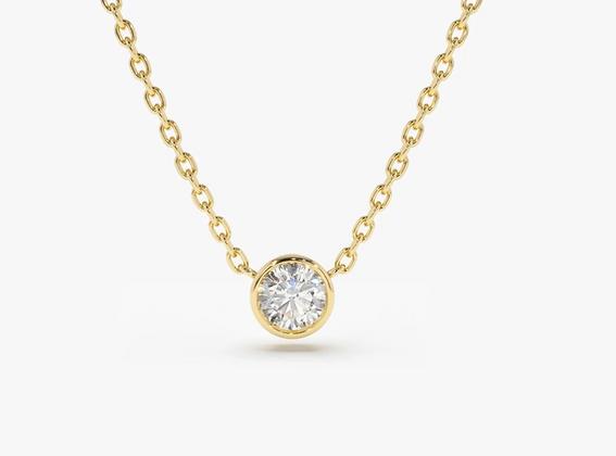 Gold bezel set diamond solitaire pendant